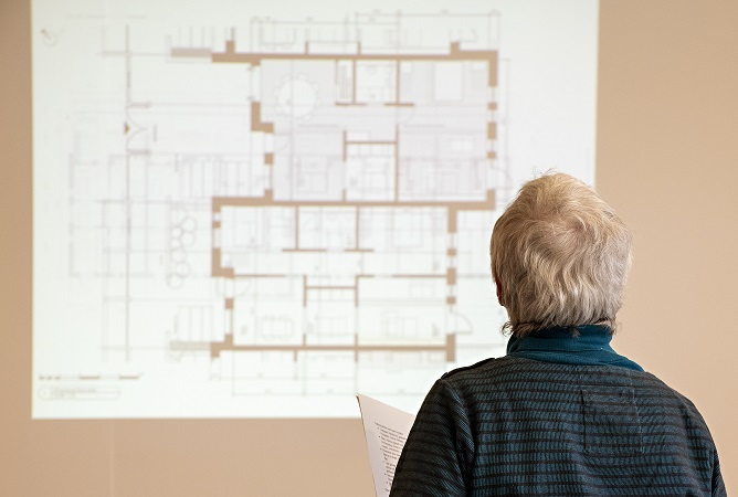 Woman looking at floorplans